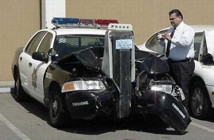 cop car wrapped around a pay phone