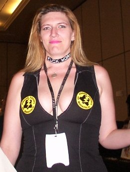 Some girl at Defcon 9 wearing stickers on her boobs.